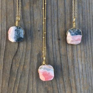 Shop Rhodochrosite Pendants! Chakra Jewelry / Rhodochrosite / Rhodochrosite Necklace / Rhodochrosite Pendant / Rhodochrosite Jewelry / Raw Rhodochrosite / Gold Filled | Natural genuine Rhodochrosite pendants. Buy crystal jewelry, handmade handcrafted artisan jewelry for women.  Unique handmade gift ideas. #jewelry #beadedpendants #beadedjewelry #gift #shopping #handmadejewelry #fashion #style #product #pendants #affiliate #ad
