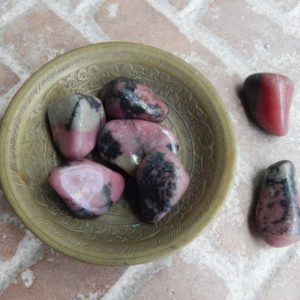 Shop Tumbled Rhodonite Crystals & Pocket Stones! Vibrant Rhodonite Tumbled Stone | Natural genuine stones & crystals in various shapes & sizes. Buy raw cut, tumbled, or polished gemstones for making jewelry or crystal healing energy vibration raising reiki stones. #crystals #gemstones #crystalhealing #crystalsandgemstones #energyhealing #affiliate #ad