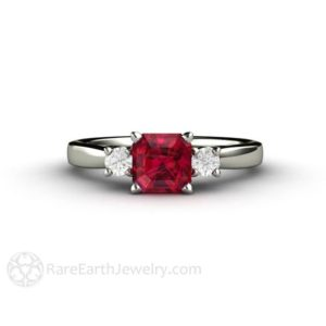 Ruby Engagement Ring 3 Stone Ruby Ring with Diamonds 14K or 18K Gold or Platinum Red Gemstone Ring July Birthstone | Natural genuine Array rings, simple unique alternative gemstone engagement rings. #rings #jewelry #bridal #wedding #jewelryaccessories #engagementrings #weddingideas #affiliate #ad