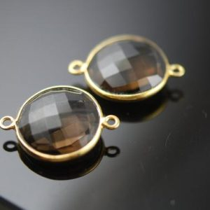 Shop Smoky Quartz Shapes! 1 smokey quartz coin connector 10.00 ON SALE 9.00 | Natural genuine stones & crystals in various shapes & sizes. Buy raw cut, tumbled, or polished gemstones for making jewelry or crystal healing energy vibration raising reiki stones. #crystals #gemstones #crystalhealing #crystalsandgemstones #energyhealing #affiliate #ad