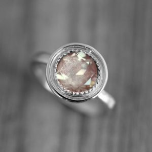 14k Palladium White Gold and Oregon Sunstone Halo Ring, Vintage Inspired Engagement Ring with Milgrain Detail, Made To Order | Natural genuine Sunstone rings, simple unique alternative gemstone engagement rings. #rings #jewelry #bridal #wedding #jewelryaccessories #engagementrings #weddingideas #affiliate #ad