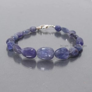 Shop Tanzanite Bracelets! AAA++ Natural Tanzanite Beaded Bracelet, Tanzanite Smooth/Plain Tumble Bead Bracelet// 7.5 Inch Bracelet, Tanzanite Halloween Beaded Jewelry | Natural genuine Tanzanite bracelets. Buy crystal jewelry, handmade handcrafted artisan jewelry for women.  Unique handmade gift ideas. #jewelry #beadedbracelets #beadedjewelry #gift #shopping #handmadejewelry #fashion #style #product #bracelets #affiliate #ad