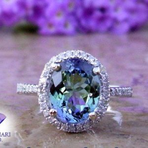 Tanzanite Engagement Ring | Tanzanite and Diamond Ring | 14kt, 18kt, or Platinum | Made To Order | Natural genuine Tanzanite rings, simple unique alternative gemstone engagement rings. #rings #jewelry #bridal #wedding #jewelryaccessories #engagementrings #weddingideas #affiliate #ad