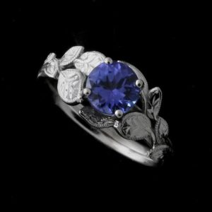 Shop Tanzanite Rings! Tanzanite Engagement Ring, Nature Inspired Ring, Leaf Engagement Ring, Solitaire Organic Style Ring, Gold Platinum Leaves Color Stone Ring | Natural genuine Tanzanite rings, simple unique alternative gemstone engagement rings. #rings #jewelry #bridal #wedding #jewelryaccessories #engagementrings #weddingideas #affiliate #ad
