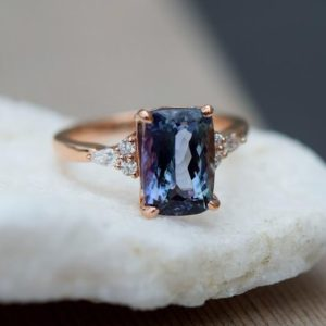Teal tanzanite engagement ring. Peacock blue tanzanite 5.03ct cushion diamond ring 14k rose gold. Campari Engagement ring by Eidelprecious. | Natural genuine Tanzanite rings, simple unique alternative gemstone engagement rings. #rings #jewelry #bridal #wedding #jewelryaccessories #engagementrings #weddingideas #affiliate #ad