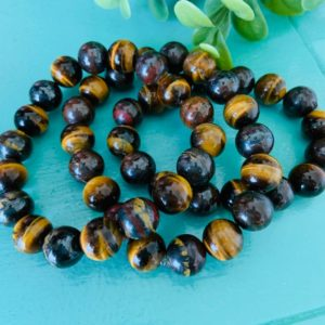 Shop Tiger Iron Bracelets! tiger eye and tiger iron beaded bracelet – chakra healing – gift for her – gift for him   Natural genuine Tiger Iron bracelets. Buy crystal jewelry, handmade handcrafted artisan jewelry for women.  Unique handmade gift ideas. #jewelry #beadedbracelets #beadedjewelry #gift #shopping #handmadejewelry #fashion #style #product #bracelets #affiliate #ad