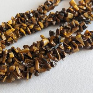 Shop Tiger Eye Chip & Nugget Beads! 4-7mm Tiger Eye Rough Chips, Tigers Eye Beaded Rope, Natural Tiger Eye Chips, Tiger Eye Necklace, 24 Inch (1Strand To 5Strand Option)-ANT161 | Natural genuine chip Tiger Eye beads for beading and jewelry making.  #jewelry #beads #beadedjewelry #diyjewelry #jewelrymaking #beadstore #beading #affiliate #ad