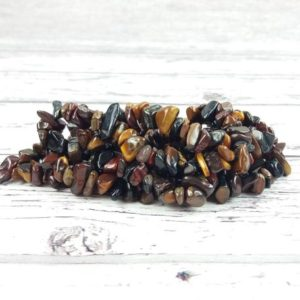 Shop Tiger Eye Chip & Nugget Beads! Tigers Eye Gemstone Beads, Crystal Chips Bag of 50 Pieces, Reiki Infused A Extra Grade Tiger Eye Beads | Natural genuine chip Tiger Eye beads for beading and jewelry making.  #jewelry #beads #beadedjewelry #diyjewelry #jewelrymaking #beadstore #beading #affiliate #ad