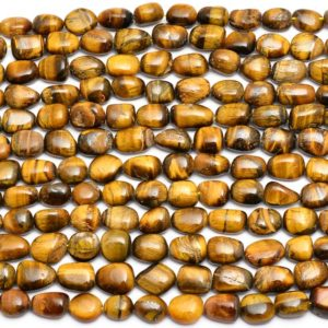 Shop Tiger Eye Chip & Nugget Beads! Yellow Tiger Eye Nuggets Beads | 10x13mm-12x15mm Oval Beads 13inch Strand| Natural Rare Yellow Tiger Eye Semiprecious Gemstone Tumbled Beads | Natural genuine chip Tiger Eye beads for beading and jewelry making.  #jewelry #beads #beadedjewelry #diyjewelry #jewelrymaking #beadstore #beading #affiliate #ad