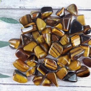 Shop Tumbled Tiger Eye Crystals & Pocket Stones! Tiger Eye Crystal Tumbled Stones, Reiki Infused Gold Tigers Eye Wire Wrapping Spiritual Stones | Natural genuine stones & crystals in various shapes & sizes. Buy raw cut, tumbled, or polished gemstones for making jewelry or crystal healing energy vibration raising reiki stones. #crystals #gemstones #crystalhealing #crystalsandgemstones #energyhealing #affiliate #ad