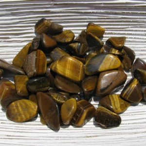 Shop Tumbled Tiger Eye Crystals & Pocket Stones! Tiger Eye – Golden Tiger Eye – Tumbled Stone – Golden Tigers Eye – Tiger's Eye Crystal – Protection Stone – Grounding Stone – Anxiety Stone | Natural genuine stones & crystals in various shapes & sizes. Buy raw cut, tumbled, or polished gemstones for making jewelry or crystal healing energy vibration raising reiki stones. #crystals #gemstones #crystalhealing #crystalsandgemstones #energyhealing #affiliate #ad