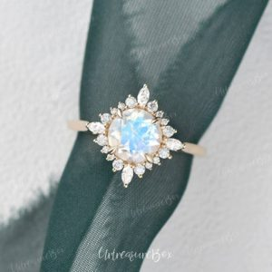 Shop Moonstone Rings! Moonstone Engagement Ring Vintage Yellow Gold Moonstone Wedding Ring Faceted Moonstone Blue Unique Halo Flower Cathedral Promise Ring | Natural genuine Moonstone rings, simple unique alternative gemstone engagement rings. #rings #jewelry #bridal #wedding #jewelryaccessories #engagementrings #weddingideas #affiliate #ad