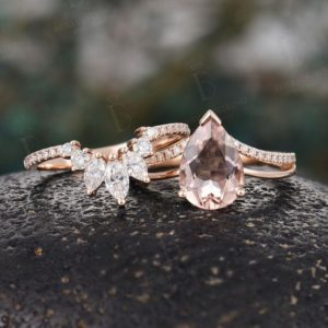 Shop Morganite Rings! Vintage Pear shaped Morganite engagement ring set rose gold at deco rings unique stacking rings moissanite Promise ring set wedding ring | Natural genuine Morganite rings, simple unique alternative gemstone engagement rings. #rings #jewelry #bridal #wedding #jewelryaccessories #engagementrings #weddingideas #affiliate #ad