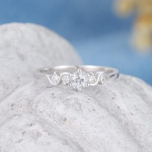 White sapphire engagement ring for women 14k white gold Unique moissanite ring Antique Bridal wedding Promise Anniversary gift ring | Natural genuine Array rings, simple unique alternative gemstone engagement rings. #rings #jewelry #bridal #wedding #jewelryaccessories #engagementrings #weddingideas #affiliate #ad