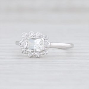 White Sapphire Ring, Diamond Halo Ring, Sapphire Halo Ring, White Sapphire Engagement Ring, 18k White Gold Ring, Size 6.75 Ring | Natural genuine Array rings, simple unique alternative gemstone engagement rings. #rings #jewelry #bridal #wedding #jewelryaccessories #engagementrings #weddingideas #affiliate #ad