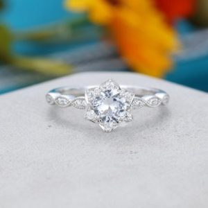 White sapphire engagement ring white gold Flower engagement ring vintage Unique Half eternity diamond wedding women Bridal Anniversary gift | Natural genuine Gemstone rings, simple unique alternative gemstone engagement rings. #rings #jewelry #bridal #wedding #jewelryaccessories #engagementrings #weddingideas #affiliate #ad