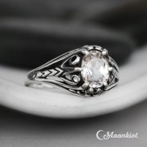 Vintage Style Silver Engagement Ring, Sterling Silver Filigree Engagement Ring, Oval White Sapphire Ring | Moonkist Designs | Natural genuine Gemstone rings, simple unique alternative gemstone engagement rings. #rings #jewelry #bridal #wedding #jewelryaccessories #engagementrings #weddingideas #affiliate #ad