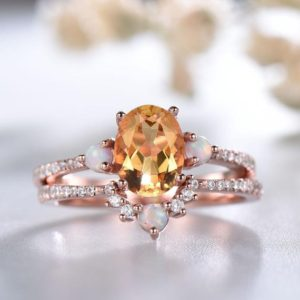 Shop Citrine Rings! Yellow Citrine Ring, November Birthstone, Oval Citrine Engagement Ring, Curved Opal Stacking Ring, Rose Gold Wedding Ring Set, Bridal Set | Natural genuine Citrine rings, simple unique alternative gemstone engagement rings. #rings #jewelry #bridal #wedding #jewelryaccessories #engagementrings #weddingideas #affiliate #ad