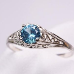 Shop Zircon Rings! Blue Zircon Ring, Genuine Gemstone 5mm Round .70ct, Filigree Style, 925 Sterling Silver Solitaire Ring | Natural genuine Zircon rings, simple unique handcrafted gemstone rings. #rings #jewelry #shopping #gift #handmade #fashion #style #affiliate #ad