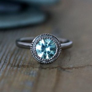 Light Blue Aqua Zircon Ring // 14k White Gold and Zircon Engagement Ring // Art Deco Inspired Gemstone Engagement Ring for the Unique Bride | Natural genuine Zircon jewelry. Buy handcrafted artisan wedding jewelry.  Unique handmade bridal jewelry gift ideas. #jewelry #beadedjewelry #gift #crystaljewelry #shopping #handmadejewelry #wedding #bridal #jewelry #affiliate #ad