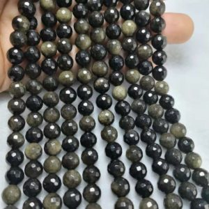 Shop Golden Obsidian Beads! 1 Full Strand 6 -10mm Natural Golden Obsidian Faceted Round Gemstone Beads , Golden Rainbow Obsidian Polished Round Beads ,Obsidian Beads | Natural genuine faceted Golden Obsidian beads for beading and jewelry making.  #jewelry #beads #beadedjewelry #diyjewelry #jewelrymaking #beadstore #beading #affiliate #ad