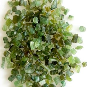 Shop Green Tourmaline Stones & Crystals! 50 Carat lot of green tourmaline natural shape raw crystals , healing power green tourmaline rough , hand broken | Natural genuine stones & crystals in various shapes & sizes. Buy raw cut, tumbled, or polished gemstones for making jewelry or crystal healing energy vibration raising reiki stones. #crystals #gemstones #crystalhealing #crystalsandgemstones #energyhealing #affiliate #ad