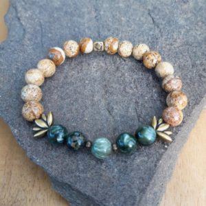 Shop Seraphinite Bracelets! 8mm Seraphinite And Jasper Landscape Bracelet With These Bronze-colored Lotus Metal Beads | Natural genuine Seraphinite bracelets. Buy crystal jewelry, handmade handcrafted artisan jewelry for women.  Unique handmade gift ideas. #jewelry #beadedbracelets #beadedjewelry #gift #shopping #handmadejewelry #fashion #style #product #bracelets #affiliate #ad