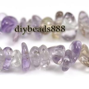 Shop Ametrine Chip & Nugget Beads! 35 inch strand of Ametrine chips beads 5-10mm   Natural genuine chip Ametrine beads for beading and jewelry making.  #jewelry #beads #beadedjewelry #diyjewelry #jewelrymaking #beadstore #beading #affiliate #ad
