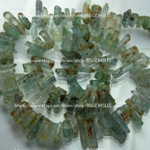 Shop Aquamarine Points & Wands! 7 Inches Strand,Natural Aquamarine Stick.8-16mm | Natural genuine stones & crystals in various shapes & sizes. Buy raw cut, tumbled, or polished gemstones for making jewelry or crystal healing energy vibration raising reiki stones. #crystals #gemstones #crystalhealing #crystalsandgemstones #energyhealing #affiliate #ad