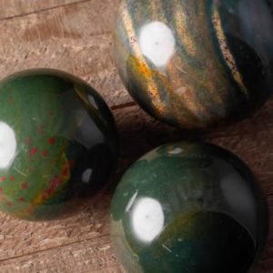 Shop Bloodstone Shapes! Bloodstone Crystal Sphere – Crystal Ball,  Housewarming Gift, Home Decor, E0957 | Natural genuine stones & crystals in various shapes & sizes. Buy raw cut, tumbled, or polished gemstones for making jewelry or crystal healing energy vibration raising reiki stones. #crystals #gemstones #crystalhealing #crystalsandgemstones #energyhealing #affiliate #ad