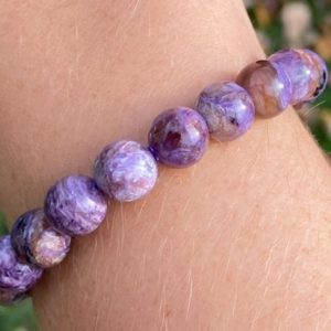 Charoite Gemstone Bracelet 10mm Purple Chatoyant Crystal Healing Jewelry Stretchy Beaded Bracelet  Round Beads #1 | Natural genuine Gemstone bracelets. Buy crystal jewelry, handmade handcrafted artisan jewelry for women.  Unique handmade gift ideas. #jewelry #beadedbracelets #beadedjewelry #gift #shopping #handmadejewelry #fashion #style #product #bracelets #affiliate #ad