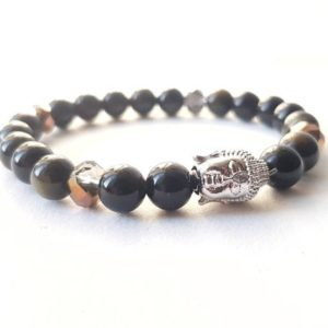 Shop Golden Obsidian Bracelets! Golden obsidian bracelet –  Buddha head – Charm bracelet – Wellbeing bracelet | Natural genuine Golden Obsidian bracelets. Buy crystal jewelry, handmade handcrafted artisan jewelry for women.  Unique handmade gift ideas. #jewelry #beadedbracelets #beadedjewelry #gift #shopping #handmadejewelry #fashion #style #product #bracelets #affiliate #ad