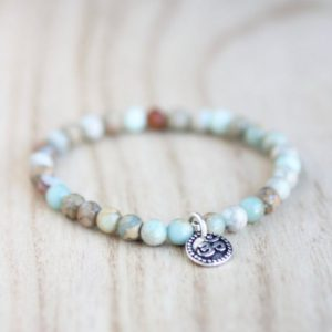 IMPRESSION JASPER Bracelet. Jasper Stretch Bracelet for Sleep Calming Bracelet Silver Om Charm Blue Gemstone Bracelet Ocean Bracelet | Natural genuine Jasper bracelets. Buy crystal jewelry, handmade handcrafted artisan jewelry for women.  Unique handmade gift ideas. #jewelry #beadedbracelets #beadedjewelry #gift #shopping #handmadejewelry #fashion #style #product #bracelets #affiliate #ad