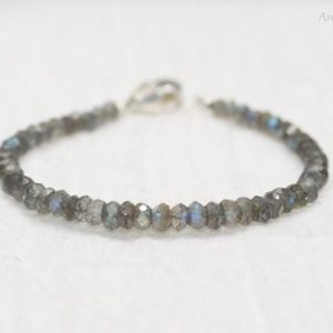 Shop Labradorite Jewelry! Labradorite Bracelet, Labradorite Jewelry, Wire Wrapped Hanging Stone, Sterling Silver, Blue Flash, Gemstone Jewelry | Natural genuine Labradorite jewelry. Buy crystal jewelry, handmade handcrafted artisan jewelry for women.  Unique handmade gift ideas. #jewelry #beadedjewelry #beadedjewelry #gift #shopping #handmadejewelry #fashion #style #product #jewelry #affiliate #ad