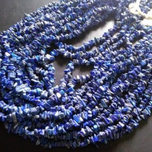 Shop Lapis Lazuli Chip & Nugget Beads! 3mm to 5mm approx.. Blue Lapis lazuli 16 inch uncut beads strand, lapis lazuli chips beads, uncut beads lapis, chips beads lapis lazuli | Natural genuine chip Lapis Lazuli beads for beading and jewelry making.  #jewelry #beads #beadedjewelry #diyjewelry #jewelrymaking #beadstore #beading #affiliate #ad