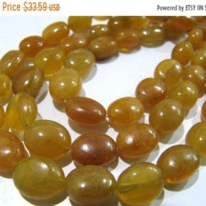 ON SALE AAA Quality Natural Yellow Sapphire Oval Shape 8 to 10mm Plain Smooth Yellow Color Jewelry Making Beads Strand 8 inches long sold pe | Natural genuine beads Array beads for beading and jewelry making.  #jewelry #beads #beadedjewelry #diyjewelry #jewelrymaking #beadstore #beading #affiliate #ad