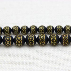 Shop Onyx Bead Shapes! Matte Black Onyx Carved Chinese Wealth Coin Beads 8mm 10mm, Black Gold Gemstone Beads, Ancient Coin Beads, Money Feng Shui Decor Supplies | Natural genuine other-shape Onyx beads for beading and jewelry making.  #jewelry #beads #beadedjewelry #diyjewelry #jewelrymaking #beadstore #beading #affiliate #ad
