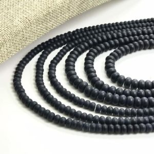 Shop Onyx Rondelle Beads! NEW Matte Black Onyx Roundel Beads, 6mm, Full Strand 15.5 Inches, Hole size 0.8mm, Natural Gemstone Beads | Natural genuine rondelle Onyx beads for beading and jewelry making.  #jewelry #beads #beadedjewelry #diyjewelry #jewelrymaking #beadstore #beading #affiliate #ad