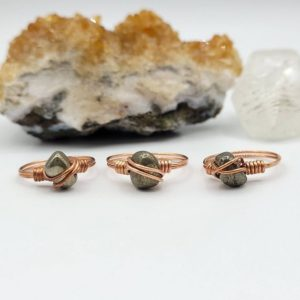 Shop Pyrite Rings! Pyrite Ring, Copper Wire Wrapped Ring | Natural genuine Pyrite rings, simple unique handcrafted gemstone rings. #rings #jewelry #shopping #gift #handmade #fashion #style #affiliate #ad
