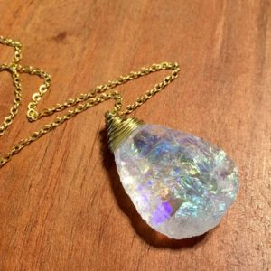 Shop Angel Aura Quartz Necklaces! Large Raw Angel Aura Quartz Necklace | Natural genuine Angel Aura Quartz necklaces. Buy crystal jewelry, handmade handcrafted artisan jewelry for women.  Unique handmade gift ideas. #jewelry #beadednecklaces #beadedjewelry #gift #shopping #handmadejewelry #fashion #style #product #necklaces #affiliate #ad