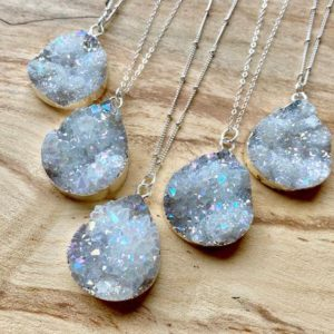 Shop Angel Aura Quartz Necklaces! Raw druzy necklace Angel Aura Quartz necklace Druzy geode necklace Raw druzy jewelry for women Rainbow quartz crystal necklace Raw stone | Natural genuine Angel Aura Quartz necklaces. Buy crystal jewelry, handmade handcrafted artisan jewelry for women.  Unique handmade gift ideas. #jewelry #beadednecklaces #beadedjewelry #gift #shopping #handmadejewelry #fashion #style #product #necklaces #affiliate #ad