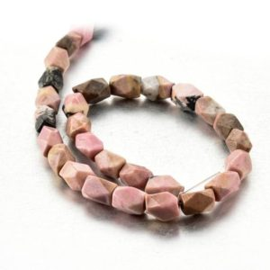 Shop Rhodonite Faceted Beads! Red Rhodonite Barrel Beads Faceted Nugget Beads 8*10mm Full Strand Wholesale | Natural genuine faceted Rhodonite beads for beading and jewelry making.  #jewelry #beads #beadedjewelry #diyjewelry #jewelrymaking #beadstore #beading #affiliate #ad