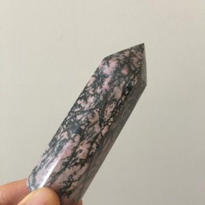 Shop Rhodonite Points & Wands! Rhodonite Point, Top Quality Rhodonite | Natural genuine stones & crystals in various shapes & sizes. Buy raw cut, tumbled, or polished gemstones for making jewelry or crystal healing energy vibration raising reiki stones. #crystals #gemstones #crystalhealing #crystalsandgemstones #energyhealing #affiliate #ad