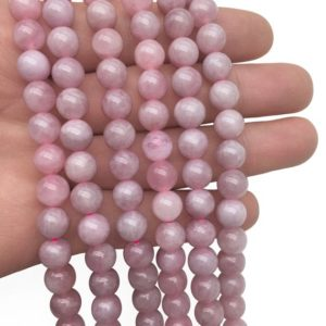Shop Rose Quartz Round Beads! 10mm Madagascar Rose Quartz Beads, Round Gemstone Beads, Wholesale Beads | Natural genuine round Rose Quartz beads for beading and jewelry making.  #jewelry #beads #beadedjewelry #diyjewelry #jewelrymaking #beadstore #beading #affiliate #ad