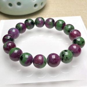 Shop Ruby Zoisite Bracelets! 12mm Top Quality Charming Natural Ruby Zoisite Bracelet,Round beads,Jewelry Making Design Bracelet,Boutique Bracelet,Valentine Crystal Gift | Natural genuine Ruby Zoisite bracelets. Buy crystal jewelry, handmade handcrafted artisan jewelry for women.  Unique handmade gift ideas. #jewelry #beadedbracelets #beadedjewelry #gift #shopping #handmadejewelry #fashion #style #product #bracelets #affiliate #ad
