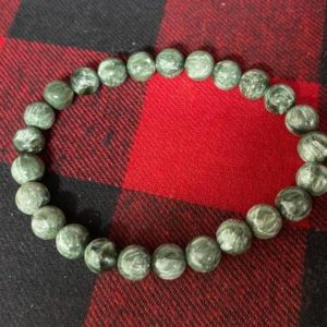Shop Seraphinite Bracelets! Russian Green Seraphinite Bracelet 8mm Beads | Natural genuine Seraphinite bracelets. Buy crystal jewelry, handmade handcrafted artisan jewelry for women.  Unique handmade gift ideas. #jewelry #beadedbracelets #beadedjewelry #gift #shopping #handmadejewelry #fashion #style #product #bracelets #affiliate #ad