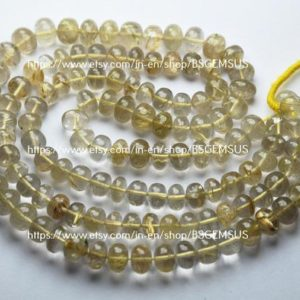 Shop Rutilated Quartz Rondelle Beads! 7 Inches Strand,Natural Golden Rutilated Quartz Smooth Rondelle,Size 8-8.5mm | Natural genuine rondelle Rutilated Quartz beads for beading and jewelry making.  #jewelry #beads #beadedjewelry #diyjewelry #jewelrymaking #beadstore #beading #affiliate #ad