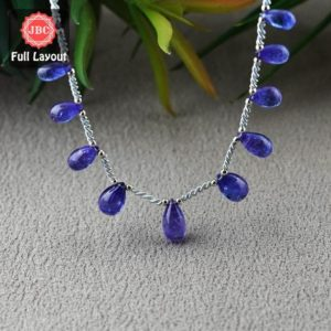 Shop Tanzanite Bead Shapes! Natural Tanzanite 10.5-13mm Smooth Drops Shape Gemstone Beads / Approx. 11 Pieces on 8 Inch Long Layout / JBC-ET-156782 | Natural genuine other-shape Tanzanite beads for beading and jewelry making.  #jewelry #beads #beadedjewelry #diyjewelry #jewelrymaking #beadstore #beading #affiliate #ad