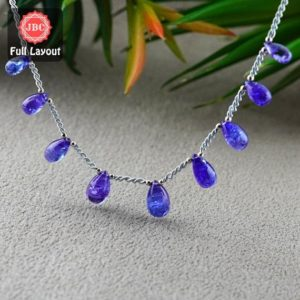 Shop Tanzanite Bead Shapes! Natural Tanzanite 10.5-13.5mm Smooth Drops Shape Gemstone Beads / Approx. 9 Pieces On 8 Inch Long Layout / Jbc-et-156788 | Natural genuine other-shape Tanzanite beads for beading and jewelry making.  #jewelry #beads #beadedjewelry #diyjewelry #jewelrymaking #beadstore #beading #affiliate #ad