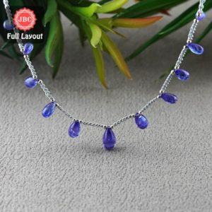 Shop Tanzanite Bead Shapes! Natural Tanzanite 8.5-12.5mm Smooth Drops Shape Gemstone Beads / Approx. 11 Pieces On 9 Inch Long Layout / Jbc-et-156797 | Natural genuine other-shape Tanzanite beads for beading and jewelry making.  #jewelry #beads #beadedjewelry #diyjewelry #jewelrymaking #beadstore #beading #affiliate #ad
